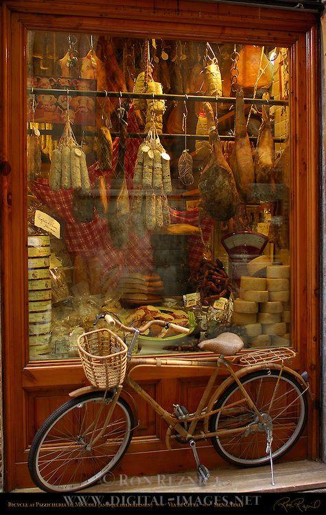 Bicycle at Pizzicheria de Miccoli antique delicatessen, Via di Citta, Siena, Italy