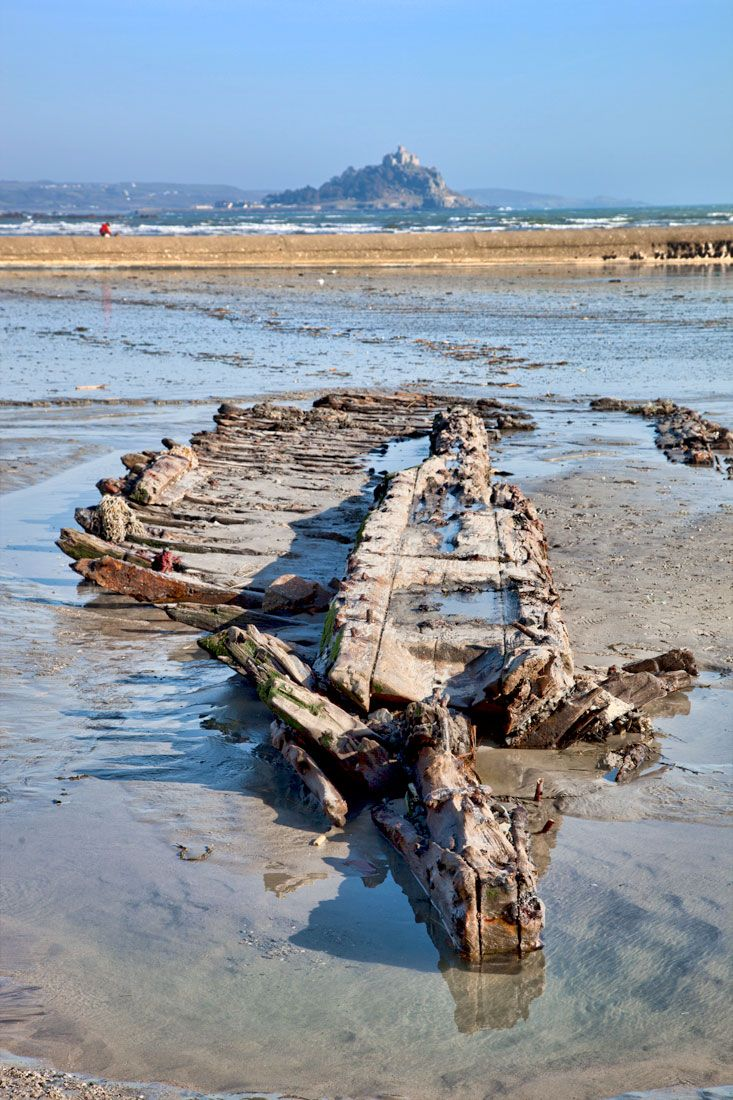 Uncovered ship wreck - Mount's Bay - Cornwall, uncovered for the first time in the storms this year, St Michael's Mount in the distance, Cornwall, England