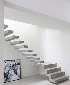 Leve e moderna, esta escada é toda de concreto armado – estrutura e degraus...