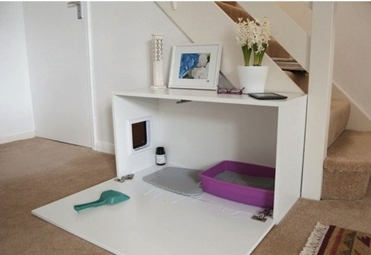 10 Ideas for Disguising or Hiding a Litter Box - The track mat is inside the enclosure, so there will be less tracking on the floor.