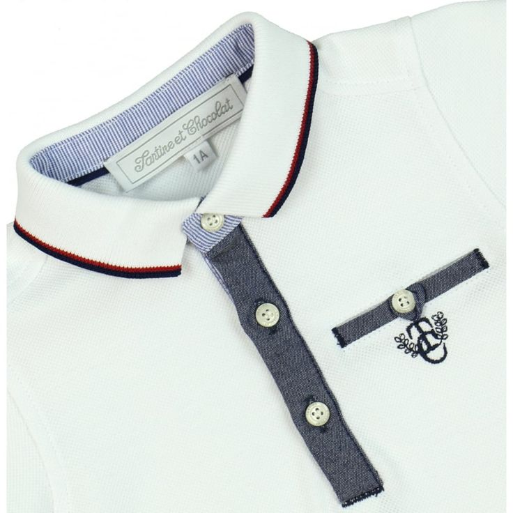 Baby Boy's Polo Shirt Style Romper with Navy Trimming. Now available at www.chocolateclothing.co.uk