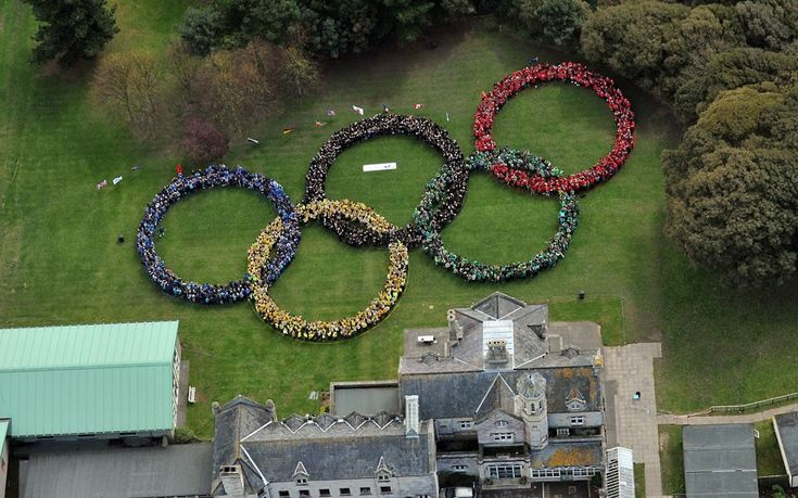 More than 2,000 pupils from Bay House School in Gosport, Hampshire, form themselves into the shape of the Olympic rings, breaking a world record