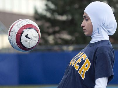 """Your beliefs shouldn't prevent you from playing sports."" Elham Seyed Javad 26-year-old University of Montreal graduate designed a sleek sports hijab, which fits tightly around the head and is part of a sports shirt underneath."
