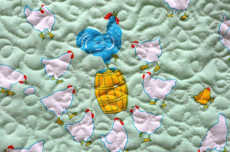 """This sweet baby quilt is made using cotton fabric.   The theme of this fabric is roosters with little chickens on minty background.  The back of the quilt is white and minty stripes fabric.  It measures approximately 36"""" x 39"""" I quilted this blanket using free motion quilting from my home sewing machine."""