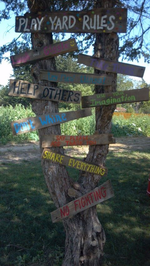 Attach signs to a tree - an attractive way to display print in the environment, and children can be involved in the making