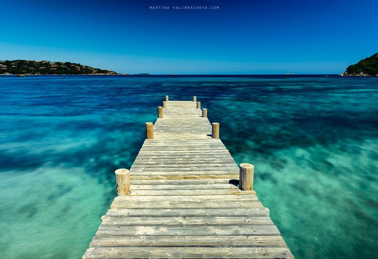 On the way to the sea - Wooden pier in the sea.