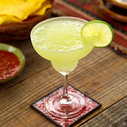 Lime wedges Kosher salt for the glasses' rims 1/2 cup juice from Mexican limóns or fresh limes 1/4 cup tequila 1 1/2 tablespoons Cointreau (orange-flavored liqueur) 2 1/2-3 tablespoons superfine sugar 12 ice cubes --- Frosty Blended Margaritas