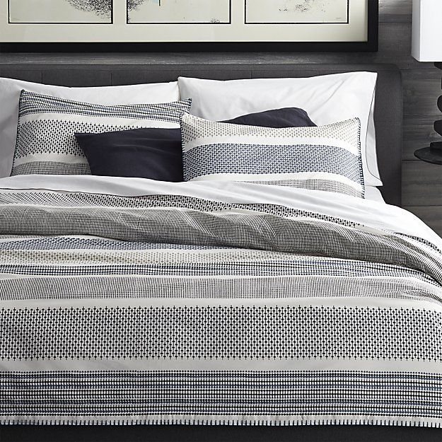 Shop Medina Full/Queen Duvet Cover.  Upon closer look, contemporary stripes of tonal blues reveal intricate traditional Indian filigree patterns.