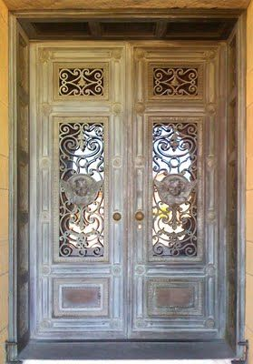Romantic scrolled wrought-iron doors.
