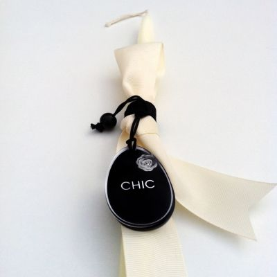 Chic in black easter candle decorated with a black stylish egg design on plexiglass and white colored ribbons. The plexiglass egg can be used afterwards as a necklace pendant. (traditionally used during the Greek Orthodox Easter and lit at midnight at the Resurrection service.) #storymood #easter #gifts #eastercandles