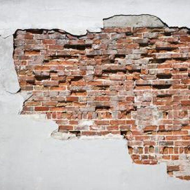 When plaster cracks, it can expose the bricks beneath it.