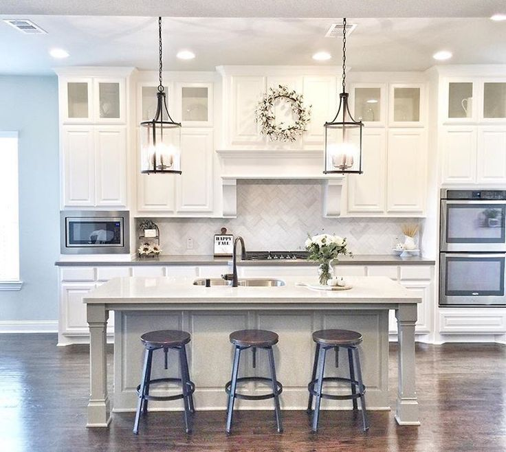 Extend cabinets to ceiling with glass cabinets.