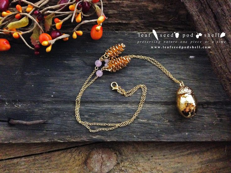 Here's another beautiful electroformed acorn pendant finished in bright gold.  Comes with two gorgeous tiny gold pine cones and four rose quartz beads.   #leafseedpodshell #leafseedpodshelljewelry #birdhouse #leaves #leaf #acorn #acorns #seeds #pods #shells #copper #electroform #electroforming #electroformed #electroplated #electroplating #nature #natural #rustic #plating #jewelry #jewellery #pendant #pendants #handmade #handmadejewelry