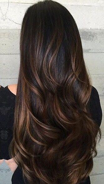 Luscious dark hair with caramel highlights
