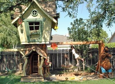 stock photos elaborate backyard swing set with treehouse