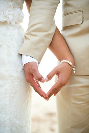 hands and heart photo idea - must have wedding day pose. I love when the groom has tan because it's pure like the bride's dress. It makes them stand out, instead of black