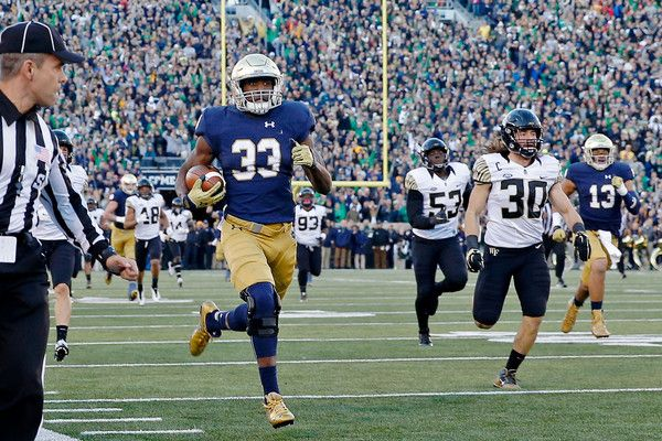 Josh Adams Photos - Josh Adams #33 of the Notre Dame Fighting Irish rushes for a 98-yard touchdown against the Wake Forest Demon Deacons during the second quarter at Notre Dame Stadium on November 14, 2015 in South Bend, Indiana. - Josh Adams Photos - 82 of 152