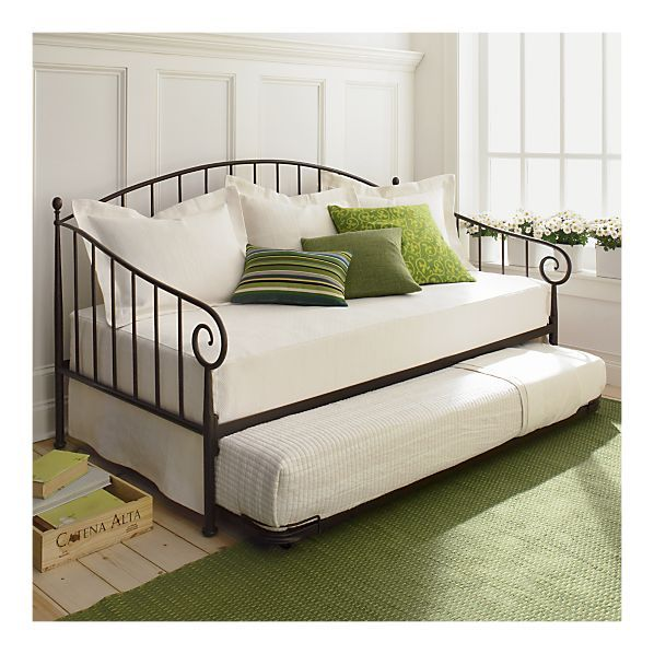 Love the white and greens and the wrought iron day bed! Great for adding guest sleeping space to an office or other small room in the house.