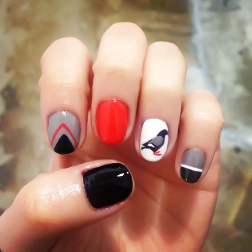 Dippednails - geometric manicure with a bird accent nail.