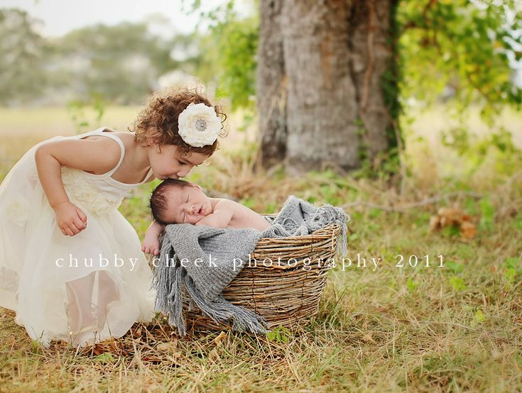 Newborn photography with sibling outdoors woods forest vintage baby boy sister brother