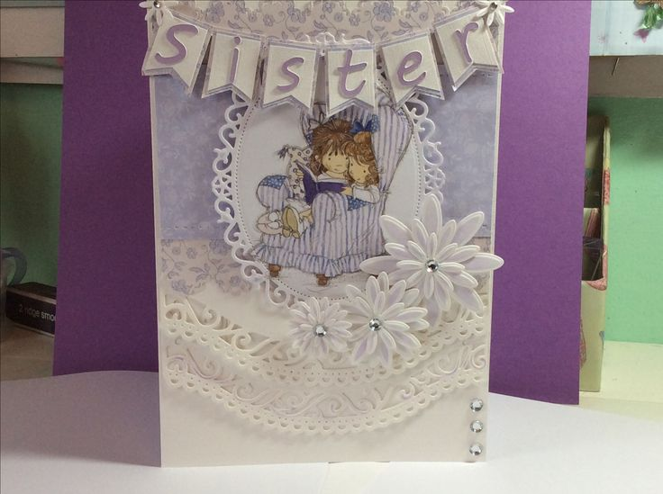 Sisters birthday card, spellbinder dies, Cricut explore for letters, crafters companion flower dies. Lilli of the valley card topper patterned paper. Distress ink:)