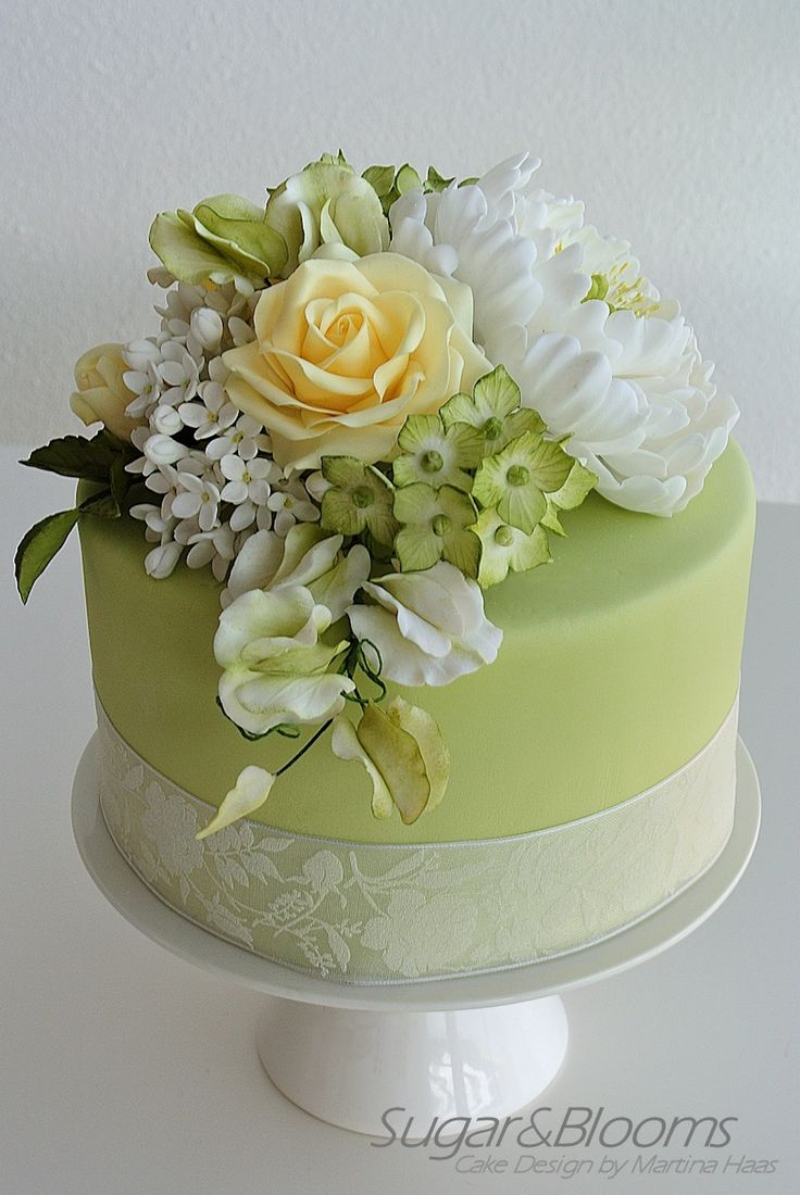 Sugar flower cake in soft green and yellow shades peonies roses