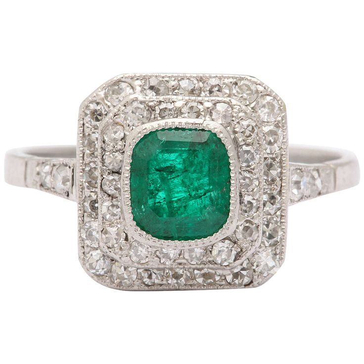 1920's Platinum Diamond and Emerald Ring | From a unique collection of vintage cluster rings at https://www.1stdibs.com/jewelry/rings/cluster-rings/