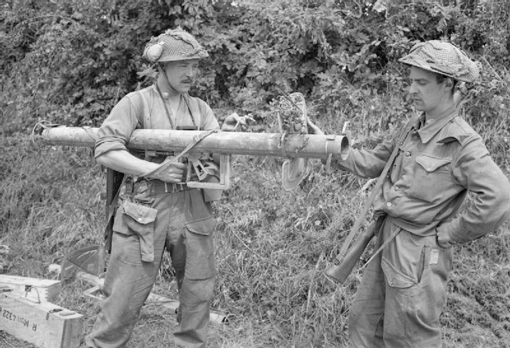 Sgt F J Petrie and Sapper L Roberts examine a captured German 'Panzerschreck' anti-tank weapon during the offensive south of Caumont, 31 July 1944.