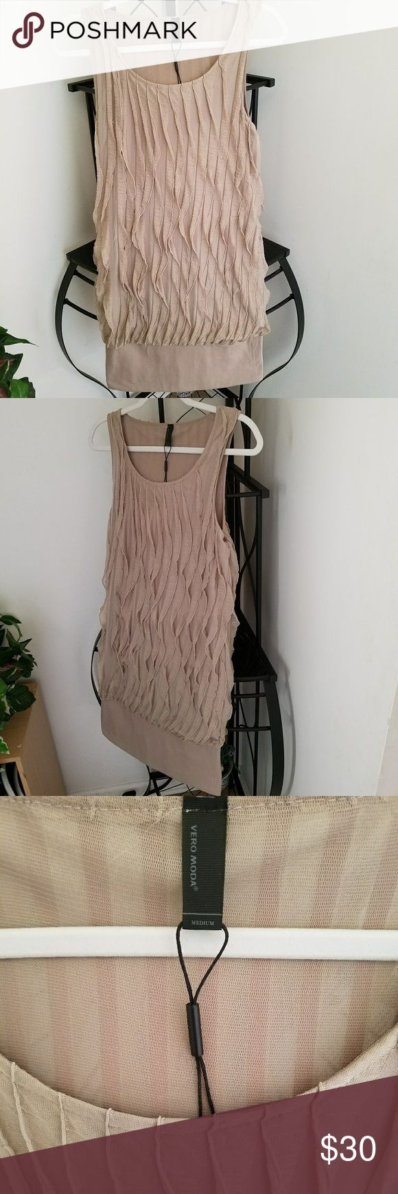 Vero Moda Mini Dress Absolutley fun and adorable Mini Dress. Nice neutral color, cool texture & pattern. Lots of different ways to style and wear this dress! Excellent quality and condition. Approximate measurements and fabric content in listing. Vero Moda Dresses Mini
