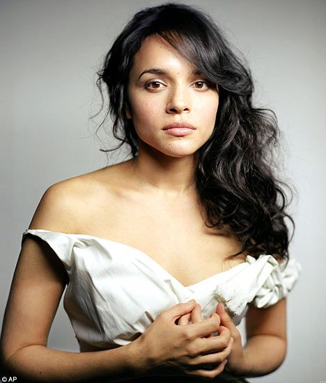 Norah Jones: Accomplished Musician, Bombshell. A Woman, not a Girl.
