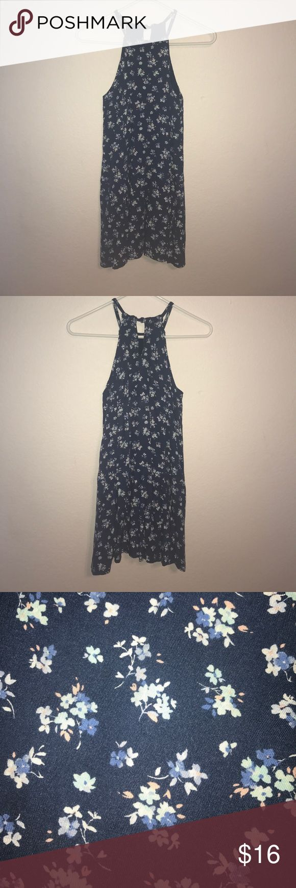 Abercrombie Kids navy, high neck, floral dress The dress has a keyhole back and a blue and white floral print. Mid to upper thigh length. Worn but in good condition- no stains or holes abercrombie kids Dresses Casual