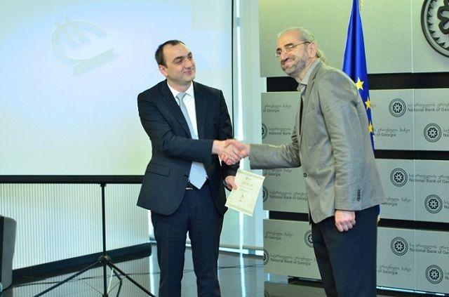 Georgian National Bank President Giorgi Kadagidze and creator of the GEL symbol Malkhaz Shvelidze.