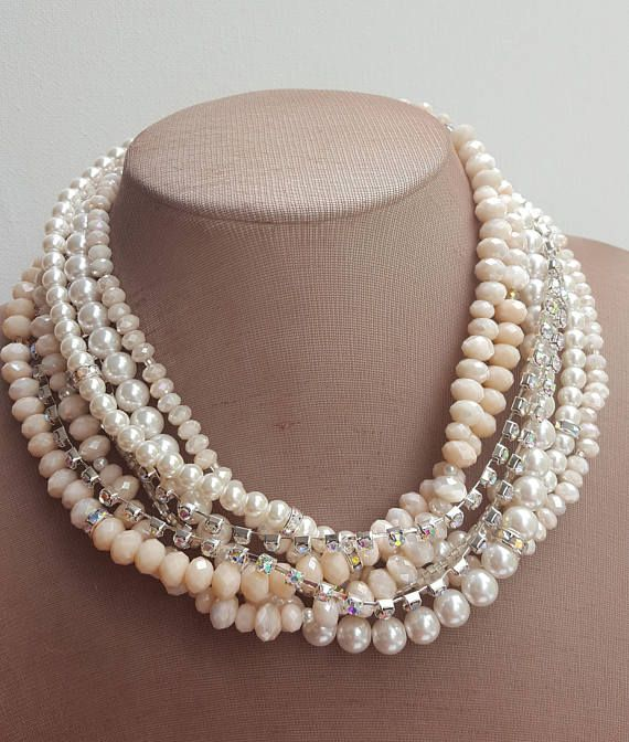 Check out this item in my Etsy shop https://www.etsy.com/ca/listing/532631263/multistrand-blush-crystal-pearl
