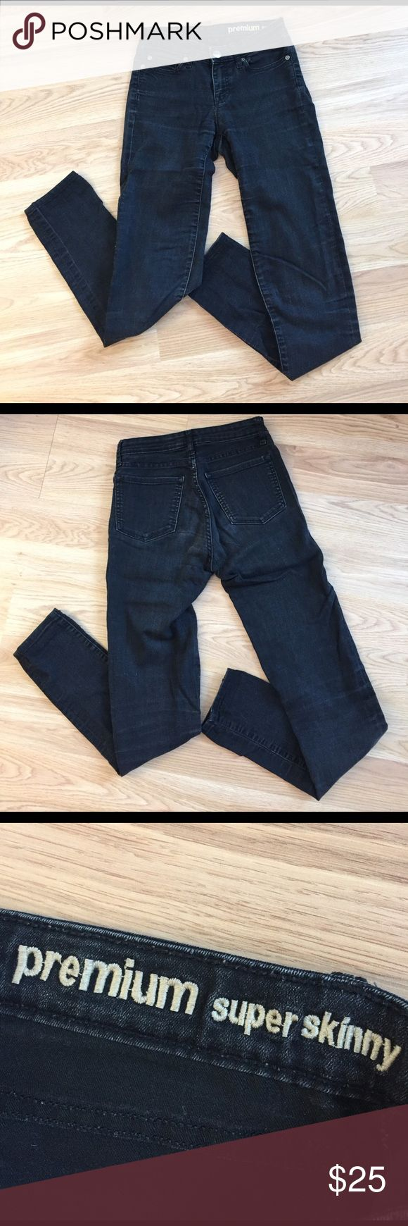 GAP Premium Super Skinny black jeans GAP Premium Super Skinny black jeans. Dark silver hardware. Incredibly stretchy and comfortable. Not completely black - have a more faded black appearance. Size 0/25R. GAP Jeans Skinny