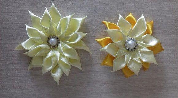 Bico de Pato com flor de cetim em diversas cores. Feito sob encomenda, 4 dias úteis para confecção. 10 em estoque.