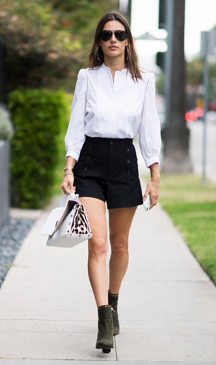 How to Wear Shorts When You're Over Age 30 via @WhoWhatWear. I love the top and the boots. The shorts are adorable, but an A-line skirt would be appropriate for my style, and proportions. Did I say that I  love those boots?!