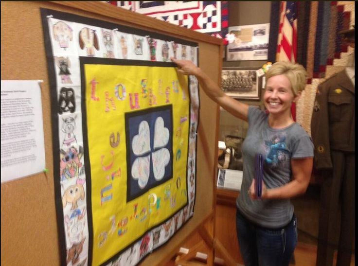 A big smile from a mom whose child's drawing and video are part of the Quilt.