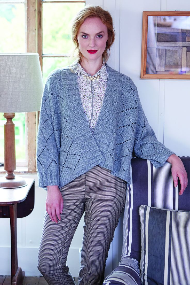 Women's grey knitted poncho-style cardigan with all-over pattern. Shop this pattern at The Knitting Network