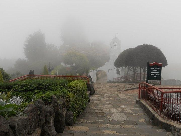 Monserrate entre las nubes en Bogotá, Colombia. A 3152 metros sobre el nivel del mar. Monserrate between the clouds in Bogota, Colombia. At 3152 meters above the sea level.