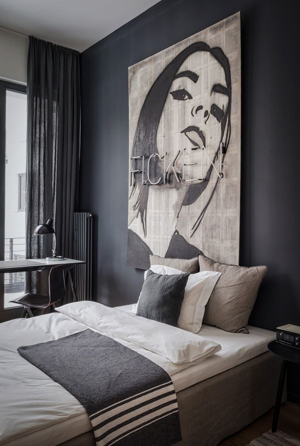 A total interiors crush on this eclectic apartment perfect for rock star wannabe's and creative types by Annabell Kutucu and Michael Schickinger.
