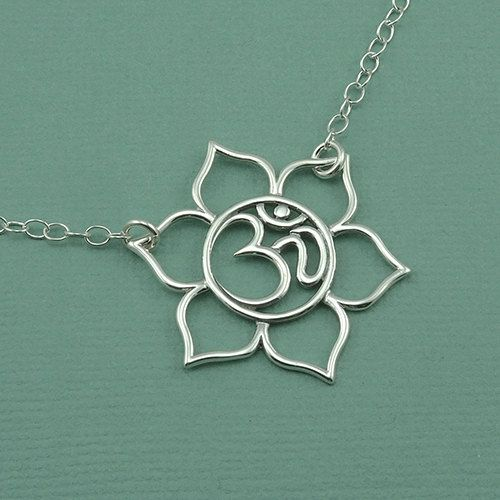 Hey, I found this really awesome Etsy listing at http://www.etsy.com/listing/153739058/floating-om-lotus-necklace-sterling