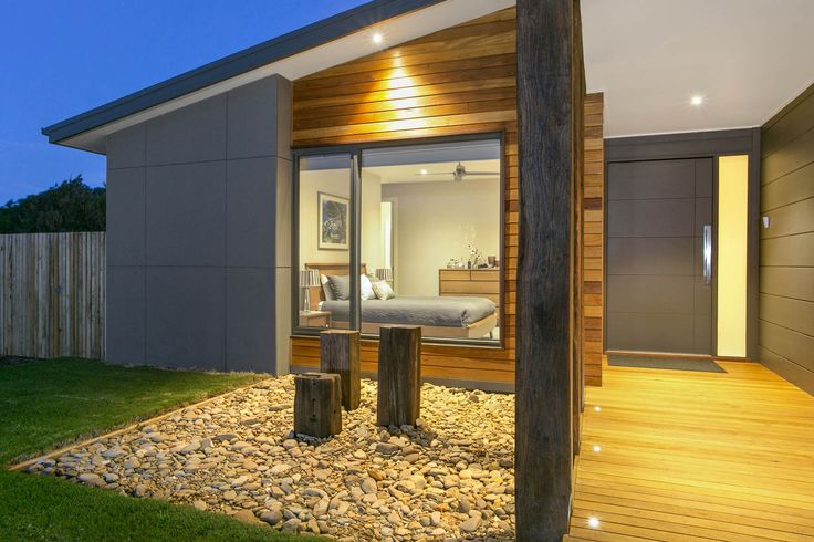 diff textures - uses three main cladding types to give it that wow factor. James Hardie Scyon Matrix, natural timber cladding as well as rendered foam. Three reclaimed timber posts welcome guests to this house in majestic style.