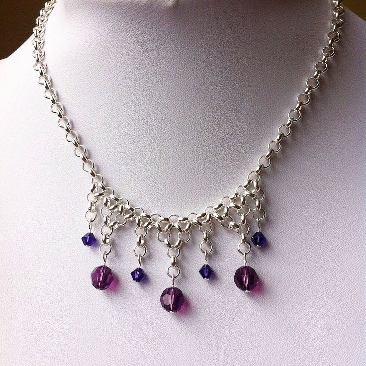Delicate silver chainmail and Swarovski necklace, handmade by IronLaceDesign! #ironlacedesign #chainmail #handmade #fantasy #vintage https://www.etsy.com/ca/listing/289133087/silver-and-purple-fringe-necklace