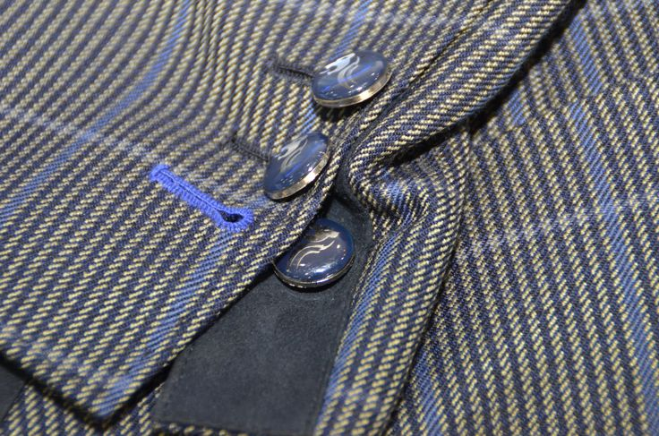 Limited Edition Designer Sports Jacket - This blue-green-grey bespoke style stripes-squares wool designer sports jacket is a very special piece with black suede patches at the elbow, on the pockets and on the sleeve sides, detailed patch pockets, hand sewn button holes, working buttons, Kinslager Lion Gold Buttons, hand stitching and fancy bluish lining. http://www.kinslager.com/men/casual/sports-jackets/limited-edition-designer-sports-jacket.html