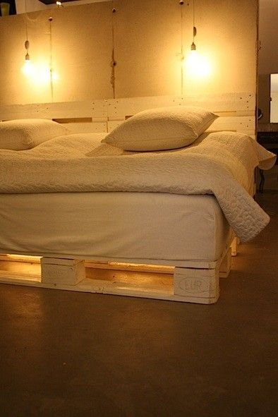 Pallet bed with lighting underneath. Romantic.