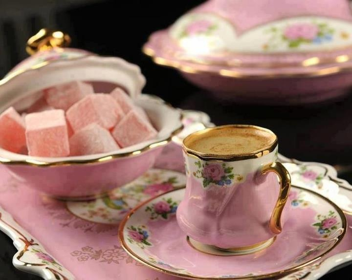 Pink/floral demitasse cups with sugar bowl full of flavored cubes..