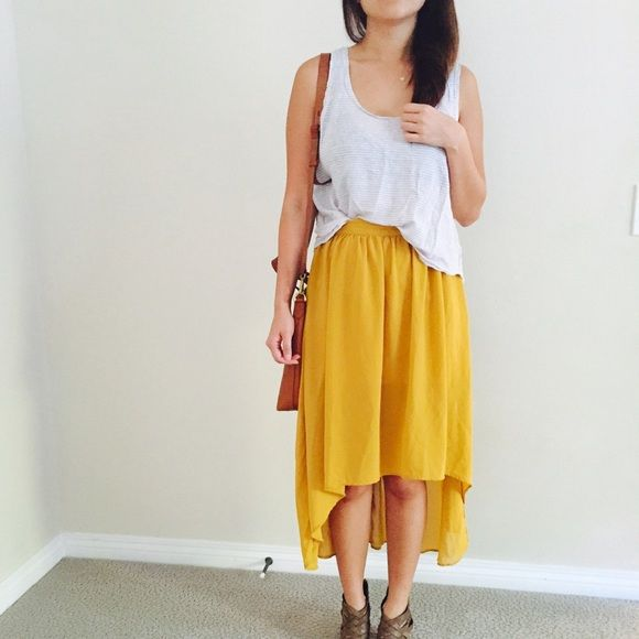 Mustard yellow hi lo skirt Cute mustard yellow skirt! Hi-lo style, thick underlying skirt so completely not see through, pretty chiffon like overlay, goes with a lot of different types of tops. My waist is about 25-26 inches and it fits perfectly Forever 21 Skirts High Low