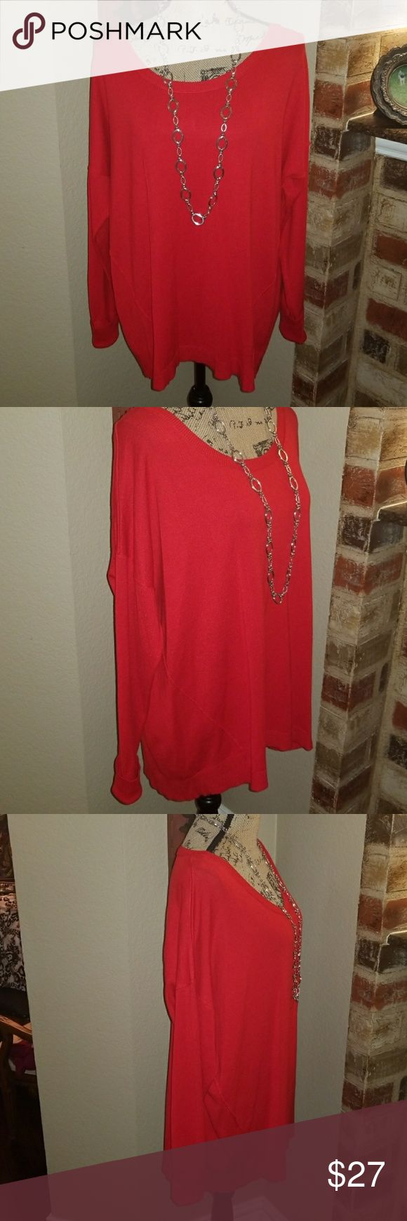 Lane Bryant Candy Apple Red Tunic. Orgas red light weight sweater tunic. So rich and made so well. It has A detail of piping trim It goes down the back and on the each front side Of the sweater for a richer look. This is a 14/16 and will look great with jeans or slacks. Brand-new with tags I am putting my fall out early so you can snatch up a great price...Material is 72% rayon with 28 % nylon. Just so luxurious! Lane Bryant Sweaters