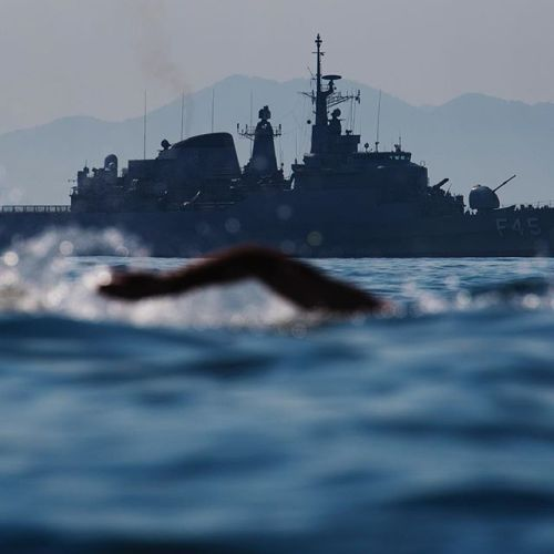A #photographer on work mode is like being a hawk thats hyper alert you cant afford taking a break even for a second - do it and you just might miss the critical shot that you need. Here a naval ship is seen in the background while a swimmer competed in womens 10 km marathon swimming during the 2016 Olympic Games in Rio. I like this image because the foreground and background tells the story of how challenging the race was - @joelmarklund #NikonAmbassador #instagramtakeover…