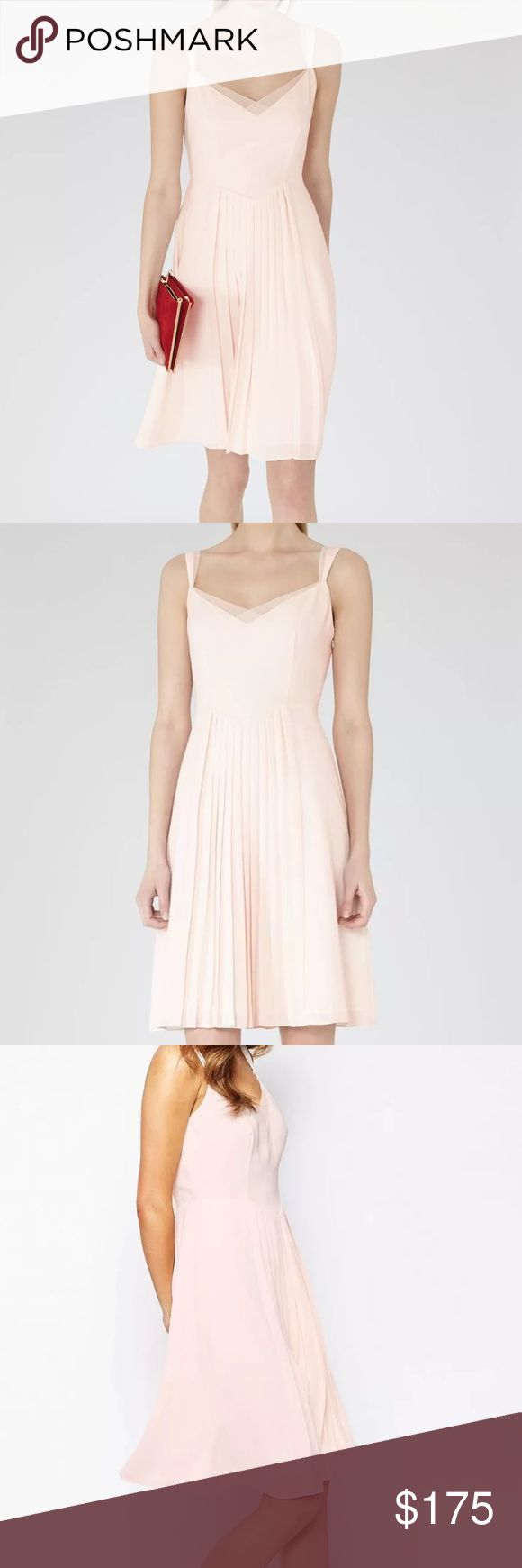 REISS cream pink tulle dress v neck mini pleated New without original tags, has tj maxx tag instead $370 Reiss Lychee Light Pink / Cream sleeveless Pleated dress in women's size 12. This is a gorgeous dress, and soft and lightweight. Has a hidden zipper. Smoke and pet free home. Back has a deep v with a sheer gossamer trip. Dress is lined as well. Such an elegant and classic style, Kate Middleton frequently wears Reiss dresses! No trades Reiss Dresses Mini